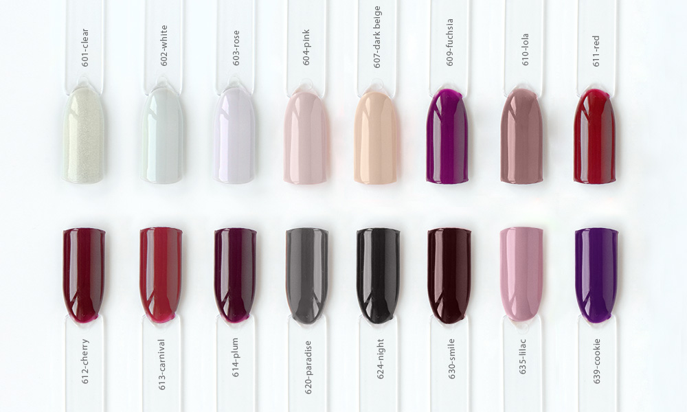 Nail polish samples in different bright colors. Colorful nail lacquer manicure swatches. Top view of nail art samples palette. Free copy space.
